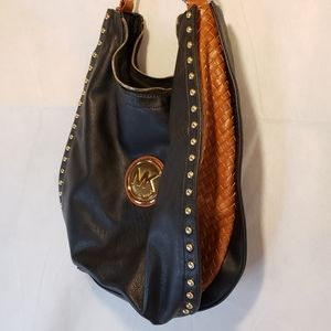 MK black and brown weaved leather purse